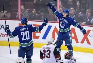 Panik's OT goal lifts Canucks past Coyotes 4-3