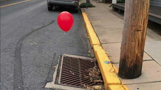 Police 'terrified' by red 'It' balloons tied to sewer grates