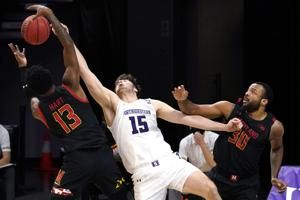 Northwestern scores last six points, beats Maryland 60-55