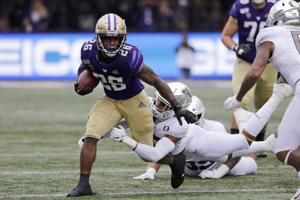 Herbert rallies No. 12 Oregon past No. 25 Washington 35-31