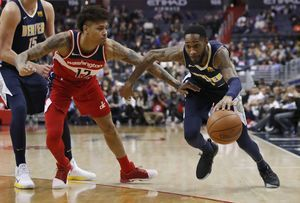 Nuggets beat Wizards to keep pace in playoff chase