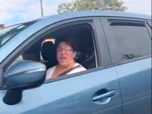 A woman made a racially offensive gesture at an Asian-American man following an alleged road rage incident