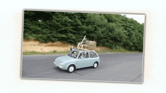 Watch Someone Drive a Nissan Pao From a Roof-Mounted Couch