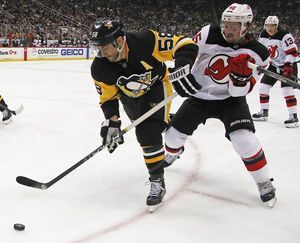 Taylor Hall scores in OT, Devils beat Penguins 4-3