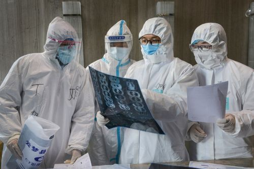 As coronavirus cases overwhelm China's hospitals, those with other problems are told to leave
