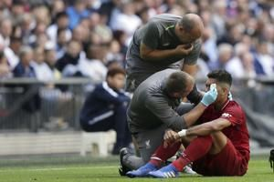 Liverpool's Firmino could miss PSG game after scratching eye