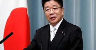 Japan minister apologizes after woman who left virus-stricken ship tests positive