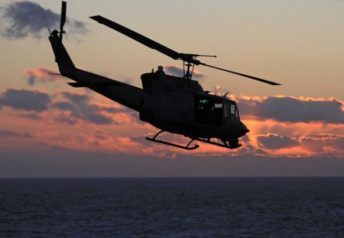 A military helicopter was shot at over Virginia, injuring a crew member
