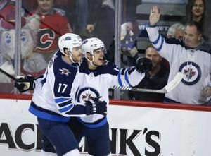 Flames score 5 goals in 1st period again to down Jets 6-3