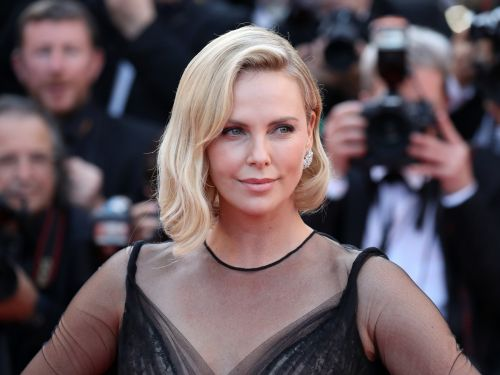Charlize Theron says she became depressed after eating junk food and gaining 50 pounds for her new role