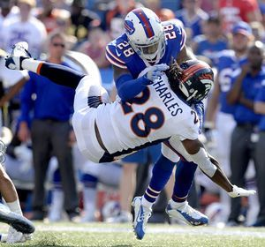 Bills overcome bottled up McCoy to beat Broncos 26-16