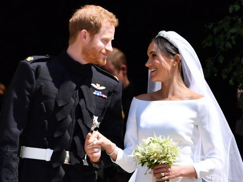 Before Prince Harry and Meghan Markle had their first kiss as husband and wife, she asked him: 'Do we kiss?'