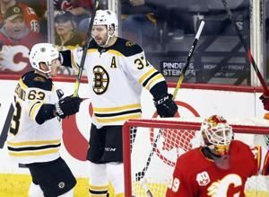 Bergeron scores twice as Bruins beat Flames 4-3