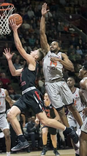 Robinson leads No. 15 Hokies to easy win over VMI