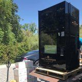 Chrissy Teigen Gave Kris Jenner a Champagne Vending Machine, and We Need New Friends