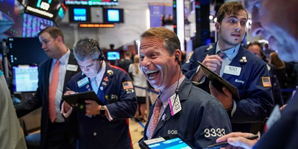 S&P 500 surges, flirts with record close as investor optimism persists