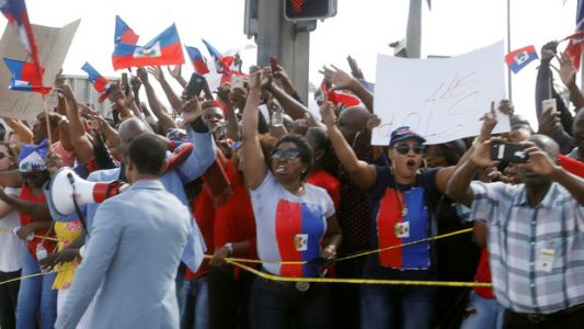 Haitians In Florida Protest Trump's 'Shithole' Comments, Demand Apology