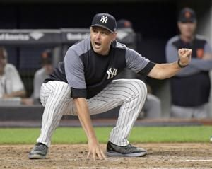 Yankees manager Boone suspended 1 game for nicking umpire