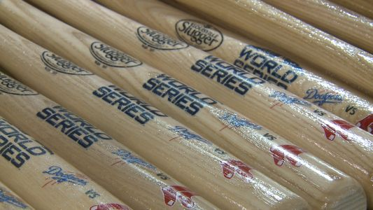 World Series commemorative bats roll off line at Louisville Slugger