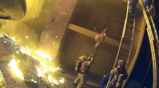 Incredible video: Firefighter catches child dropped from burning building