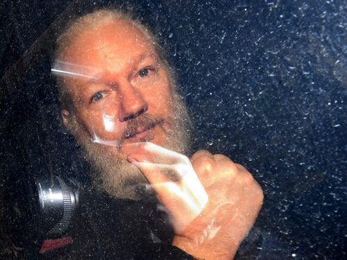 Julian Assange is facing a new federal grand jury indictment that accuses him of conspiring with 'Anonymous' hackers to access classified documents