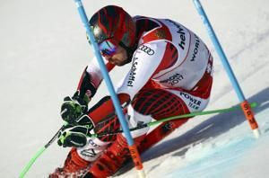 Hirscher gets off sick bed, in contention for GS gold