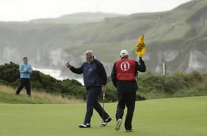 The Latest: McIlroy hits quadruple-bogey 8 at British Open