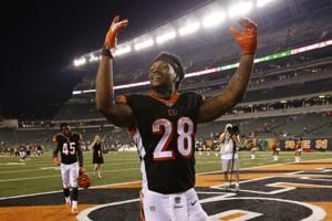 Dalton throws 4 TD passes, leads Bengals over Ravens 34-23