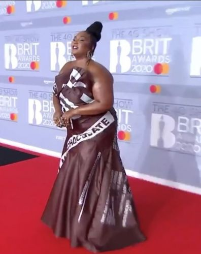 Lizzo dressed like a chocolate bar in Moschino at the Brits