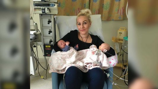 Woman who travels hours each day to see her hospitalized newborn receives free train pass