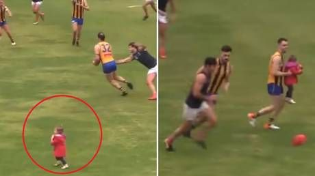 Stray toddler rescued by Aussie footballer after running onto pitch during game