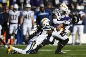 Chargers hold off Jackson, Ravens 23-17 in playoff opener
