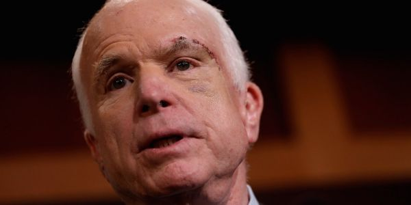 A White House staffer is accused of mocking John McCain's brain-cancer diagnosis during internal meeting