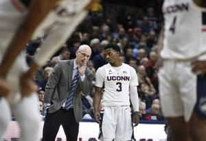 Adams, Gilbert lead UConn past SMU 76-64