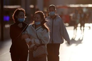 Mainland China reports nine new COVID-19 cases, down from 12 a day earlier