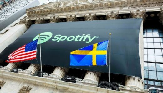 Spotify starts trading at $165.90, up 25% on NYSE reference price