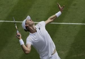 The Latest: 2016 runner-up Raonic's Wimbledon match halted