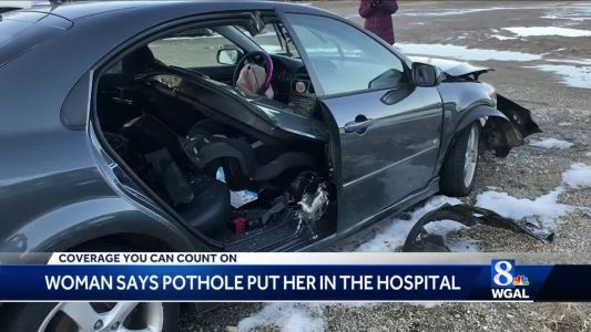 Woman says pothole put her in hospital
