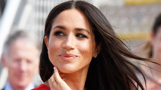 Royal Disaster! Meghan Markle Rocks A Gorgeous Red Dress. With The Tag Still On It