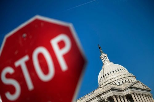 Lawmakers pointing fingers, digging in on shutdown's 1st day