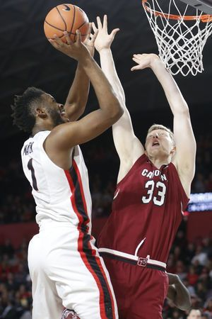 Booker's late 3s power South Carolina to 61-53 win over Dogs
