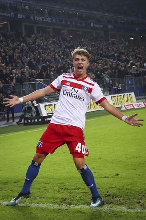 Arp scores on 1st start as Hamburg beats Stuttgart 3-1