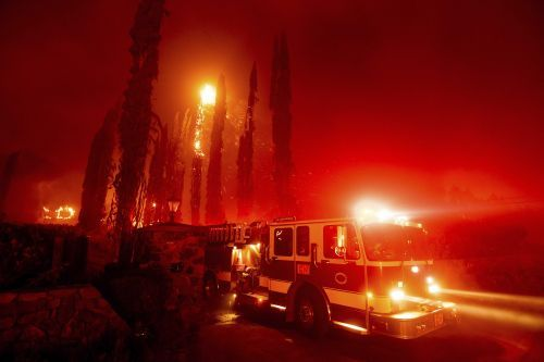 California residents again face fire anguish as homes burn, more than 50,000 evacuated overnight