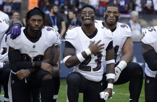PHOTOS: NFL players kneel to protest Trump's remarks