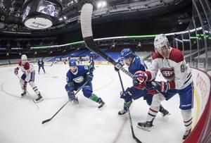 Perry scores in debut, Habs improve to 4-0-2 on road swing