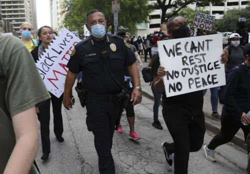Surrounded by protesters, Houston police chief makes passionate speech for community in viral video