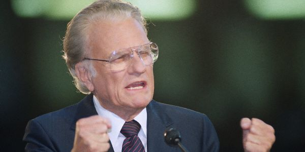 Evangelist Billy Graham dies at age 99, who went from sermonizing in a swamp to personally preaching to 210 million people worldwide