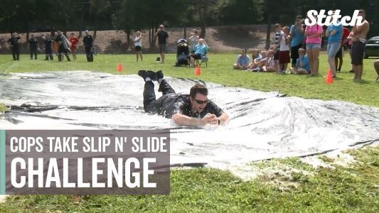 Police officers, firefighters take Slip N' Slide challenge to raise money for youth program
