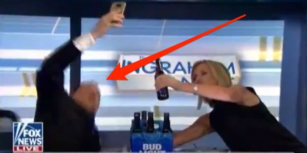 A Fox News contributor fell out of his chair on-camera while trying to take a selfie with Laura Ingraham as part of a joke