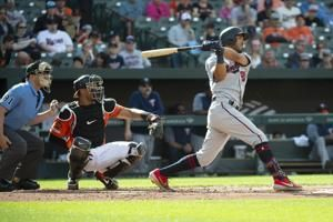 Rosario hits 2 HRs as Twins beat Orioles 6-5 in DH opener